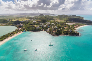 Aerial view of sailboats moored a few meters from the coast of Antigua, Leeward Islands, Caribbeanの写真素材 [FYI03773281]