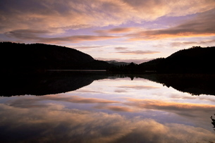 Pond reflection and clouds at dawn, Kristiansand, Norway, Scandinaviaの写真素材 [FYI03774103]
