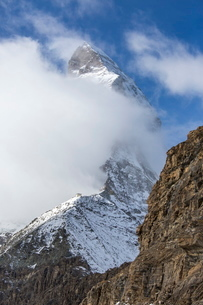 The unmistakable profile of the Matterhorn hidden by some fog, Swiss Canton of Valais, Swiss Alpsの写真素材 [FYI03777111]