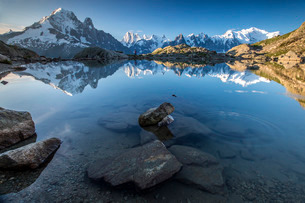 Snowy peaks of Aiguilles Verte, Dent Du Geant, and Mont Blanc are reflected in Lac Blanc, Haute Savoの写真素材 [FYI03777243]