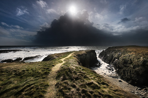 A day of mixed weather, brilliant sunshine and violent hail showers over the Irish Sea on the West cの写真素材 [FYI03777854]