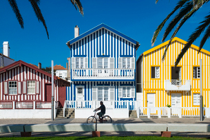 Colourful stripes decorate traditional beach house style on houses in Costa Novaの写真素材 [FYI03777865]