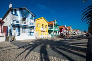 Colourful stripes decorate traditional beach house style on houses in Costa Novaの写真素材 [FYI03777869]