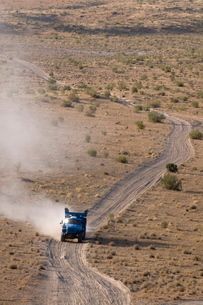 Off-road driving over dusty country road, Karakol desert, Turkmenistanの写真素材 [FYI03781038]
