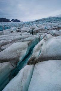Large ice crack in a huge glacier in Hornsund, Svalbard, Arcticの写真素材 [FYI03781702]