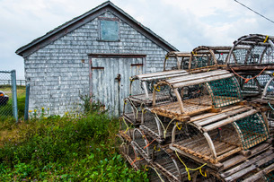 Fish traps in front of a shingle hut in Neils Harbour, Cape Breton Highlands National Park, Cape Breの写真素材 [FYI03781737]