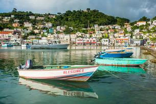 Little motoboat in the inner harbour of St. Georges, capital of Grenada, Windward Islands, Caribbeanの写真素材 [FYI03781853]