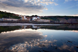 Clearing rain clouds at Robin Hoods Bay, Yorkshireの写真素材 [FYI03783002]