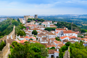 Streets and castle in the medieval walled village of Obidos in Portugal's Centro region, Portugal, Eの写真素材 [FYI03785379]