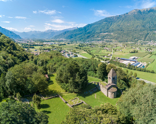 Panoramic of medieval Abbey of San Pietro in Vallate from drone, Piagno, Sondrio province, Lower Valの写真素材 [FYI03785434]