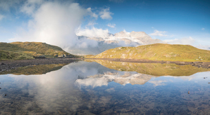 Panoramic of mountain peaks reflected in lake, Bernina Pass, Poschiavo Valley, Engadine, Canton of Gの写真素材 [FYI03785451]