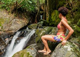Brazilian model by the Cachoeira Indiana Jones, Nova Friburgo Municipality, State of Rio de Janeiro,の写真素材 [FYI03786522]