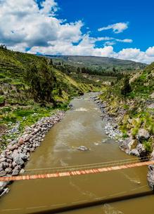 Suspension Bridge over Colca River, Chivay, Arequipa Region, Peru, South Americaの写真素材 [FYI03786584]