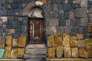 Facade of 9th century church, Sevanank Monastery, with propped up khachkars (carved memorial stones)の写真素材 [FYI03786952]