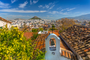 View of Athens and Likavitos Hill over the rooftops of the Plaka District, Athens, Greece, Europeの写真素材 [FYI03787414]