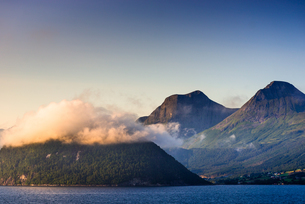 Low cloud catches the setting sun on Nordfjord (Northern Fjord), Norway, Scandinavia, Europeの写真素材 [FYI03787469]