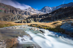 Flowing water of alpine creek, Alpe Fora, Malenco Valley, province of Sondrio, Valtellina, Lombardy,の写真素材 [FYI03787831]