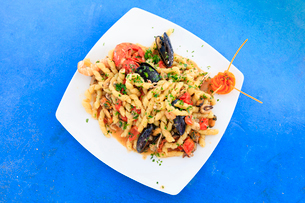 Pasta with seafood on platter, Sicily, Italy, Europeの写真素材 [FYI03787844]