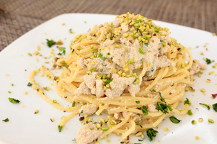 Pasta on platter with swordfish eggs garnished with Bronte pistachio, Sicily, Italy, Europeの写真素材 [FYI03787846]