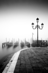 Black and white gondolas and lamp in the mist, St. Mark's Square, with Grand Canal in the backgroundの写真素材 [FYI03788790]