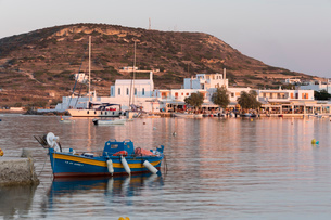 Fishing boat in harbour with town behind, Pollonia, Milos, Cyclades, Aegean Sea, Greek Islands, Greeの写真素材 [FYI03789162]
