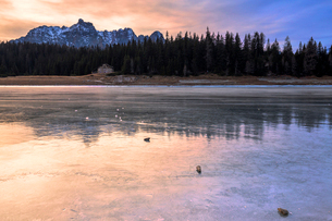 Colors of the sunset reflected on the icy surface of Lake Palu, Malenco Valley, Valtellina, Lombardyの写真素材 [FYI03790497]