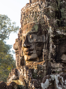 Huge stone face, Bayon Temple, Angkor Wat complex, UNESCO World Heritage Site, near Siem Reap, Camboの写真素材 [FYI03790638]