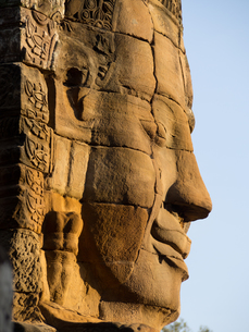 Huge stone face, Bayon Temple, Angkor Wat complex, UNESCO World Heritage Site, near Siem Reap, Camboの写真素材 [FYI03790639]