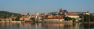 Panorama of Prague Castle, Hradcany, Mala Strana, and Charles Bridge lit by sunrise, UNESCO World Heの写真素材 [FYI03790676]