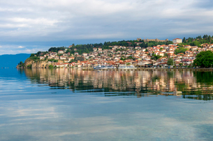 Ohrid old city reflected in Lake Ohrid, UNESCO World Heritage Site, Macedonia, Europeの写真素材 [FYI03791292]