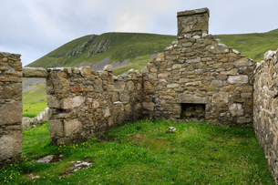 Stone remains of evacuated cottage with fireplace, Hirta, remote St. Kilda Archipelago, UNESCO Worldの写真素材 [FYI03791860]