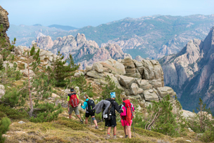 Trekking on the GR20 in Corsica near the Aiguilles de Bavella hiking towards Refuge d'Asinao, Corsicの写真素材 [FYI03791957]