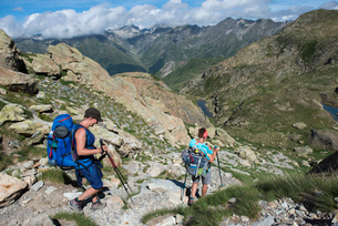 Walkers descend from the top of Pic Peyreget while hiking the GR10 trekking trail, Pyrenees Atlantiqの写真素材 [FYI03791965]