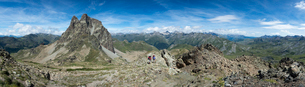 Walkers descend from the top of Pic Peyreget while hiking the GR10 trekking trail, Pyrenees Atlantiqの写真素材 [FYI03791970]