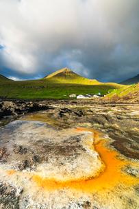 Rock formation in water, Gjogv, Eysturoy island, Faroe Islands, Denmark, Europeの写真素材 [FYI03792509]