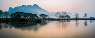 Misty morning at Kyauk Kalap Buddhist Temple at sunrise, Hpa An, Kayin State, Myanmar (Burma), Asiaの写真素材 [FYI03792914]