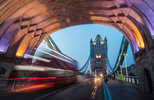 Lights on Tower Bridge over the River Thames with a typical double decker bus, London, England, Unitの写真素材 [FYI03793612]