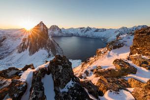 First light of suNoise on Mount Segla and Mefjorden framed by the frozen sea seen from peak Hesten,の写真素材 [FYI03793644]