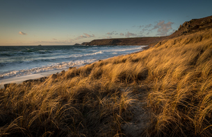 Brissons and Cape Cornwal in the far distance in the late afternoon, Sennen Beach, Sennen, Cornwall,の写真素材 [FYI03795322]