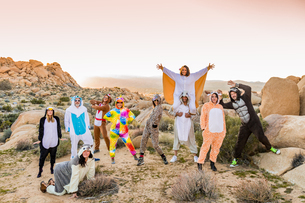 Group of friends in spirit animal onesies celebrating the new year in Joshua Tree, California, Uniteの写真素材 [FYI03795688]