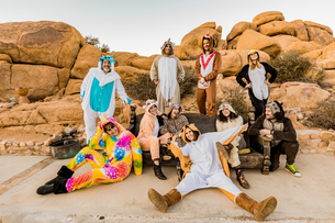 Group of friends in spirit animal onesies celebrating the new year in Joshua Tree, California, Uniteの写真素材 [FYI03795690]