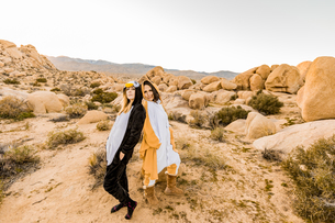 Two friends in spirit animal onesies celebrating the new year in Joshua Tree, California, United Staの写真素材 [FYI03795691]