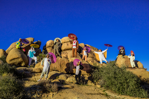Group of friends in spirit animal onesies celebrating the new year in Joshua Tree, California, Uniteの写真素材 [FYI03795692]