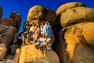 Group of friends in spirit animal onesies celebrating the new year in Joshua Tree, California, Uniteの写真素材 [FYI03795695]
