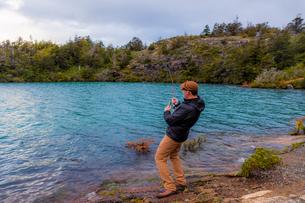 Fishing in Toro Lake, Patagonia, Chile, South Americaの写真素材 [FYI03795728]