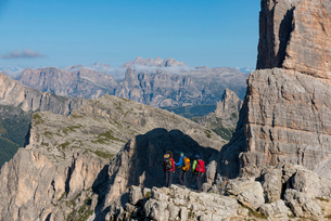 Hiking in typical mountainous terrain of the Dolomites range of the Alps on the Alta Via 1 trekkingの写真素材 [FYI03795784]