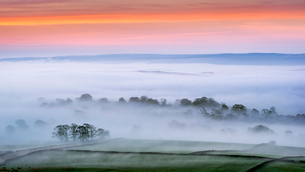 Mist rising over East Halton and Embsay at sunrise, in Lower Wharfedale, North Yorkshire, Yorkshire,の写真素材 [FYI03795887]