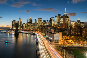 The lights of Lower Manhattan at dusk viewed from the Manhattan Bridge, New York, United States of Aの写真素材 [FYI03796586]