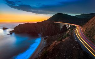 Sunset over Bixby Creek Bridge and car trail lights, Big Sur, California, United States of America,の写真素材 [FYI03797065]