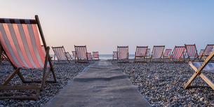 Deckchairs on the popular pebble beach at Beer near Seaton, Devon, England, United Kingdom, Europeの写真素材 [FYI03797254]